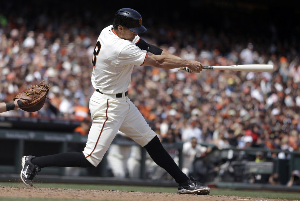 Photo - San Francisco Giants' Hunter Pence swings for a two-run single off Cleveland Indians' Zach McAllister in the fifth inning of a baseball game on Saturday, April 26, 2014, in San Francisco. (AP Photo/Ben Margot)