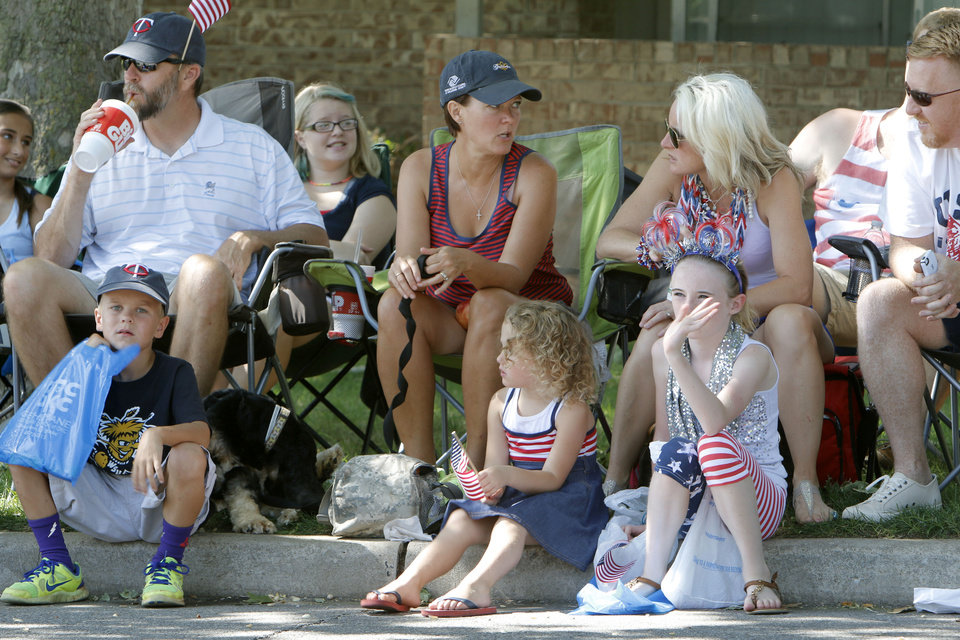 Photo - Children and parents watch Bethany's Fourth of July parade in Bethany, OK, Friday, July 4, 2014,  Photo by Paul Hellstern, The Oklahoman
