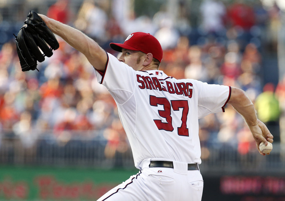 Photo - Washington Nationals starting pitcher Stephen Strasburg throws during the first inning of an interleague baseball game against the Baltimore Orioles at Nationals Park, Monday, July 7, 2014, in Washington. (AP Photo/Alex Brandon)
