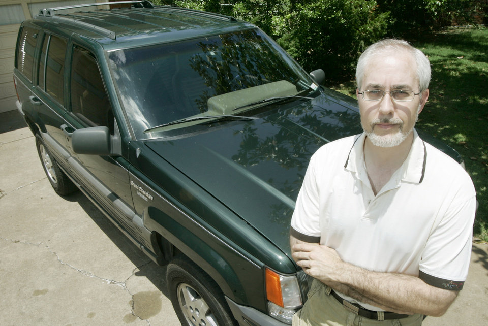 Photo - HYPERMILING, SPORT UTILITY VEHICLE, GAS, HYPERMILE: Doug Wilson poses with his SUV at his home in Midwest City, Okla. June 20 , 2008.  BY STEVE GOOCH, THE  OKLAHOMAN.  ORG XMIT: KOD