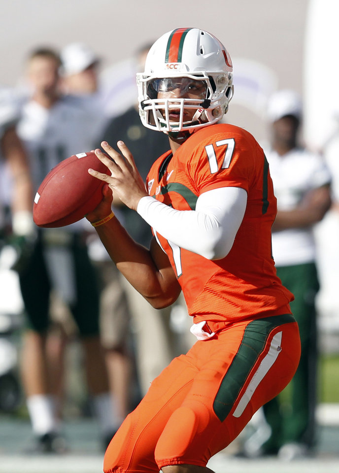 Photo -   Miami quarterback Stephen Morris drops back to pass during the first half of an NCCA college football game against South Florida, Saturday, Nov. 17, 2012, in Miami. (AP Photo/Wilfredo Lee)