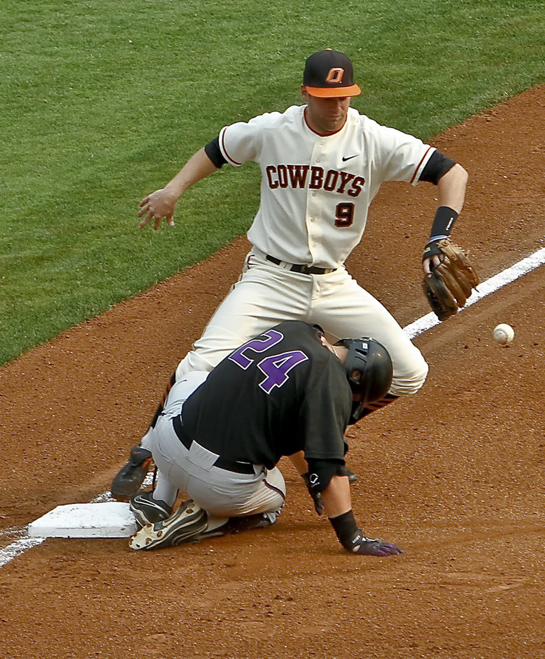 Photo - Oklahoma State's Mark Ginther (9) drops the ball as Kansas State's Randy McCurry (24) slides into third base during the Big 12 baseball tournament game between Oklahoma State University  and Kansas State University at the Chickasaw Bricktown Ballparkon Thursday, May 24, 2012, in Oklahoma City, Oklahoma. Photo by Chris Landsberger, The Oklahoman