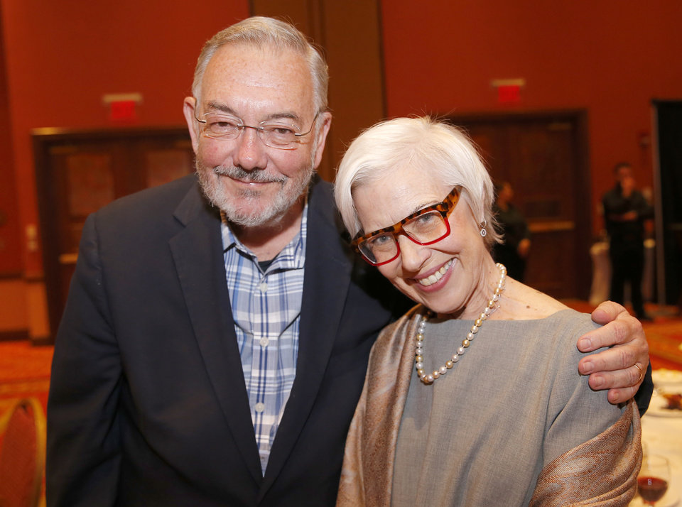 Photo - Eugene and Sherry Enrico pose for a picture before a dinner and reception honoring David and Molly Shi Boren in Norman, Okla., Friday, April 20, 2018. Photo by Sarah Phipps, The Oklahoman