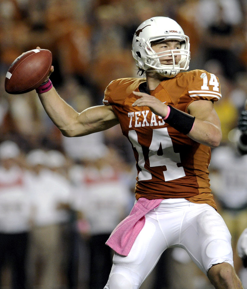 Photo -   Texas quarterback David Ash attempts a throw during the first quarter of an NCAA college football game against Baylor on Saturday, Oct. 20, 2012, in Austin, Texas. Texas won 56-50. (AP Photo/The Daily Texan, Elisabeth Dillon)