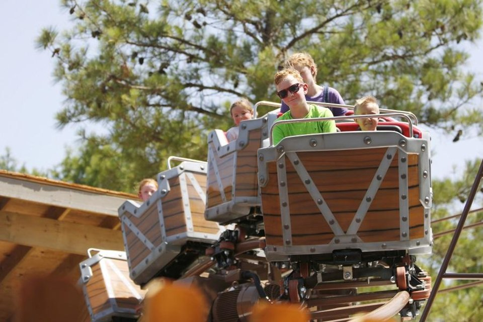 Photo - John Mankin, 9, rides Frankie's Mine Train in the Timber Town kids area of Frontier City in Oklahoma City, Oklahoma on June 28, 2019. [The Oklahoman Archives]