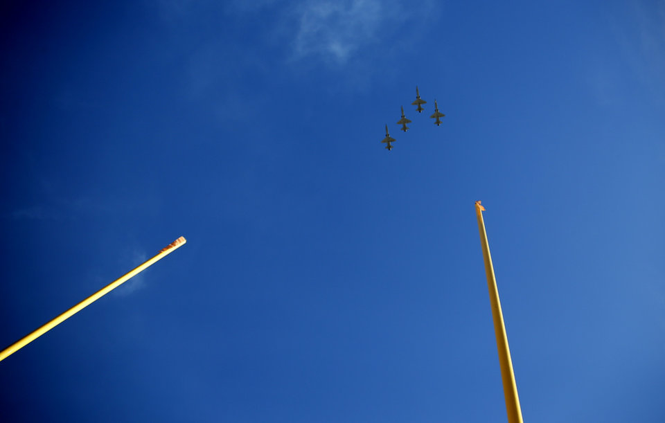 Photo - Jets from Vance Air Force base fly ove rthe stadium before the college football game between the Oklahoma State University Cowboys and the Kansas Jayhawks at Boone Pickens Stadium in Stillwater, Okla., Saturday, Nov. 16, 2019. OSU won 31-13. [Sarah Phipps/The Oklahoman]