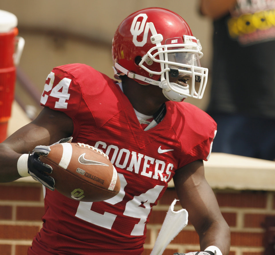 Photo - Dejuan Miller (24) scores on a pass during the University of Oklahoma Sooner's (OU) Spring Football game at Gaylord Family-Oklahoma Memorial Stadium on Saturday, April 16, 2011, in Norman, Okla.  
