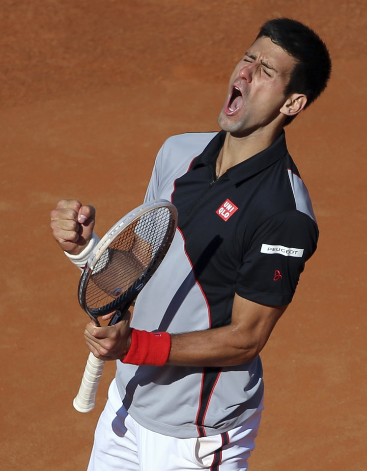 Photo - Serbia's Novak Djokovic celebrates after winning a point during his semifinal match against Canada's Milos Raonic at the Italian open tennis tournament in Rome, Saturday, May 17, 2014. Djokovic won the match and advanced to the final. (AP Photo/Gregorio Borgia)