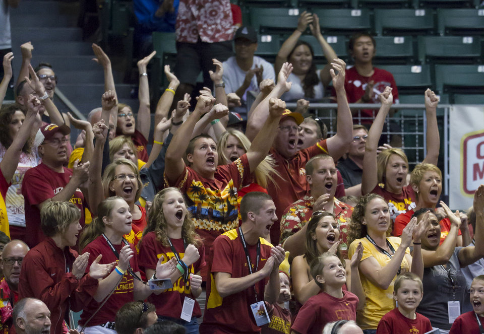 Photo - Iowa State fans cheer for their team during the second half of an NCAA college basketball game against Boise State at the Diamond Head Classic on Wednesday, Dec. 25, 2013, in Honolulu. Iowa State defeated Boise State 70-66. (AP Photo/Eugene Tanner)