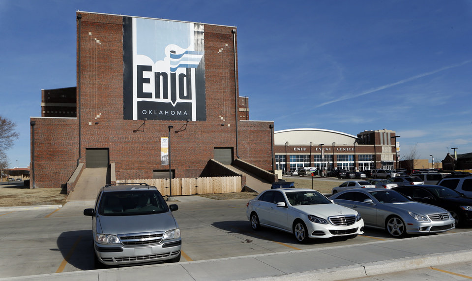 Photo - A large graphic adorns a building near downtown on Wednesday, Dec. 18, 2013 in Enid, Okla.  Photo by Steve Sisney, The Oklahoman