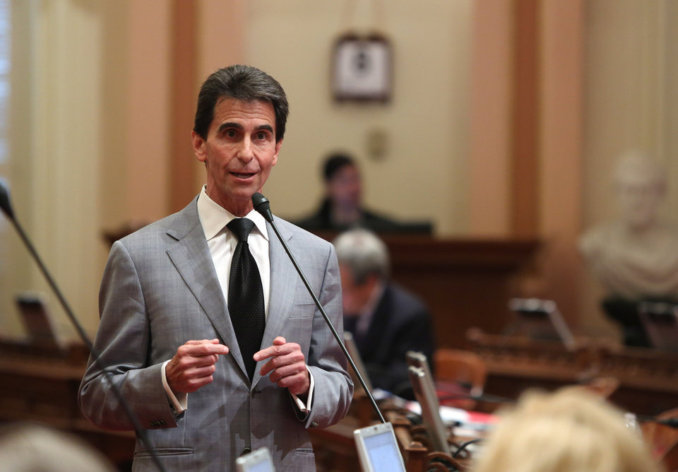 Photo - State Sen. Mark Leno, D-San Francisco, urges lawmakers to approve his measure requiring electronics manufacturers to install a shut-off function in all smartphones manufactured and sold after July 2015,  at the Capitol  in Sacramento, Calif., Thursday May 8, 2014.  The bill, SB962, which fell two votes short of passage when it was brought up two weeks ago, was approved by the Senate by a 26-8 vote. (AP Photo/Rich Pedroncelli)