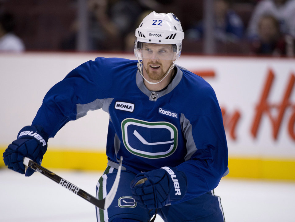 Vancouver Canucks'  Daniel Sedin, of Sweden, skates at NHL hockey training camp at Rogers Arena in Vancouver, British Columbia, Tuesday, Jan. , 15, 2013. (AP Photo/The Canadian Press, Jonathan Hayward)