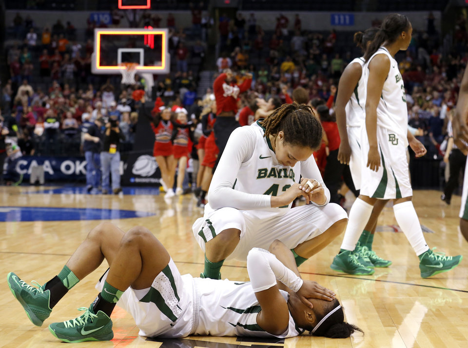 Baylo's Brittney Griner (42) and Odyssey Sims (0) react after losing to Louisville following the college basketball game between Baylor University and the Louisville at the Oklahoma City Regional for the NCAA women's college basketball tournament at Chesapeake Energy Arena in Oklahoma City, Sunday, March 31, 2013. Photo by Sarah Phipps, The Oklahoman