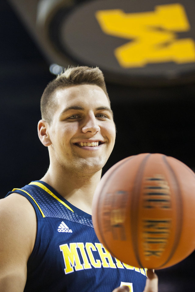 "Photo - FILE - In this Oct. 24, 2013 file photo, Michigan forward Mitch McGary poses for a portrait during the team's preseason media day in Ann Arbor, Mich. McGary is entering the NBA draft, saying he had little choice after testing positive for marijuana during the NCAA tournament. ""I am ready to move on to the next stage in my life and enter the NBA draft,"" the 6-foot-10 McGary said in a statement released by the school Friday, April 25, 2014. (AP Photo/Tony Ding, File)"