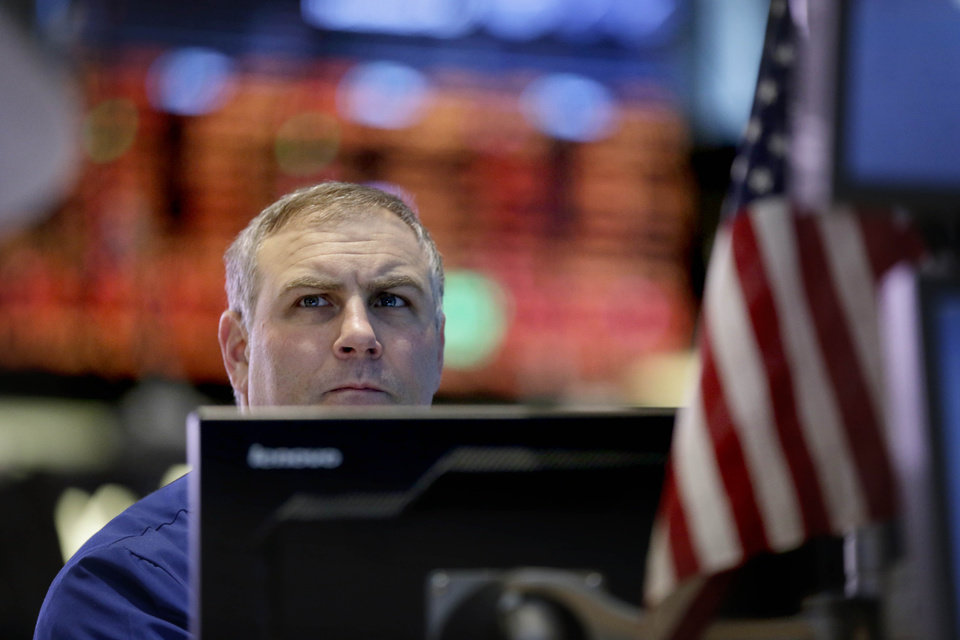 Photo - A trader works on the floor at the New York Stock Exchange in New York, Friday, Dec. 28, 2012. Stocks were heading lower Friday, for a fifth day, on concern that Washington lawmakers will fail to reach a budget deal before a year-end deadline. (AP Photo/Seth Wenig)
