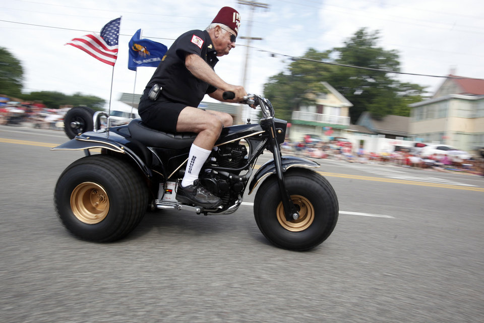 Photo - An India Shriner performs during the LibertyFest Parade in Edmond, Okla., Monday, July 4, 2011. Photo by Sarah Phipps, The Oklahoman