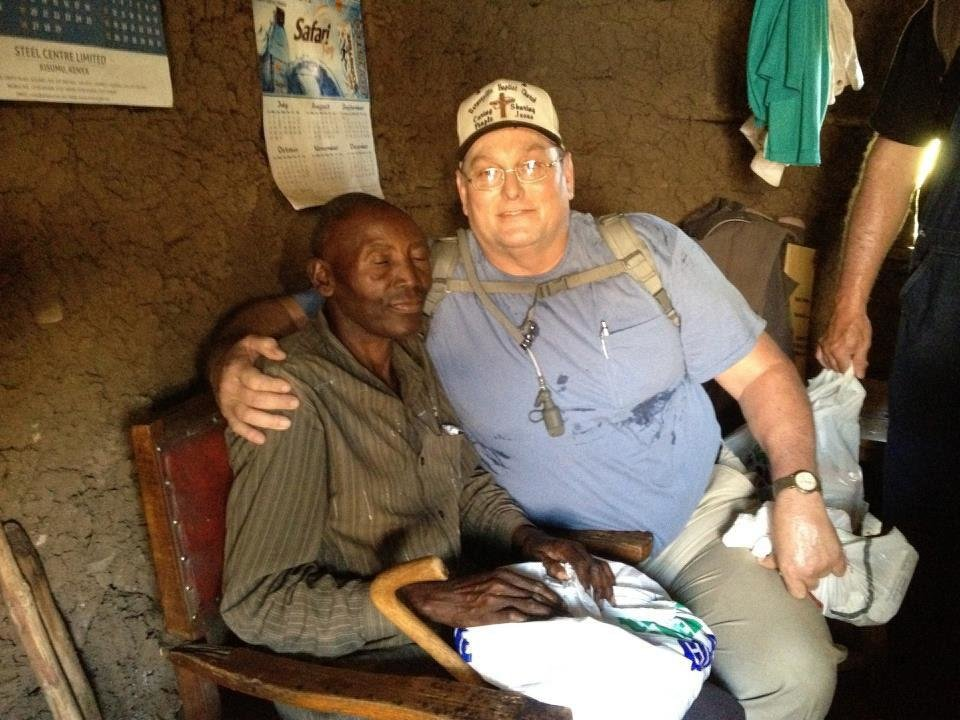 The Rev. Mark Gunnels, at right, shares a hug with a Kenyan man during a Choctaw Road Baptist Church mission trip to the Maisha International Orphanage and surrounding villages. Photo provided <strong></strong>