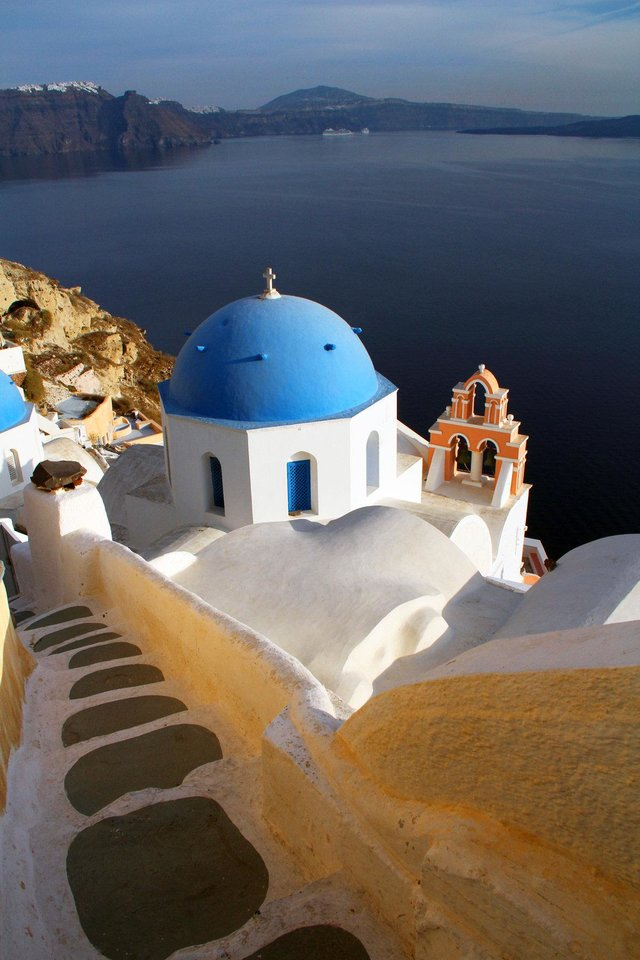 Photo - A visit to the Greek isle of Santorini should be less expensive this year, due to the nation's economic crisis.    Photo by Patrick O'Connor   Photo by Patrick O'Connor