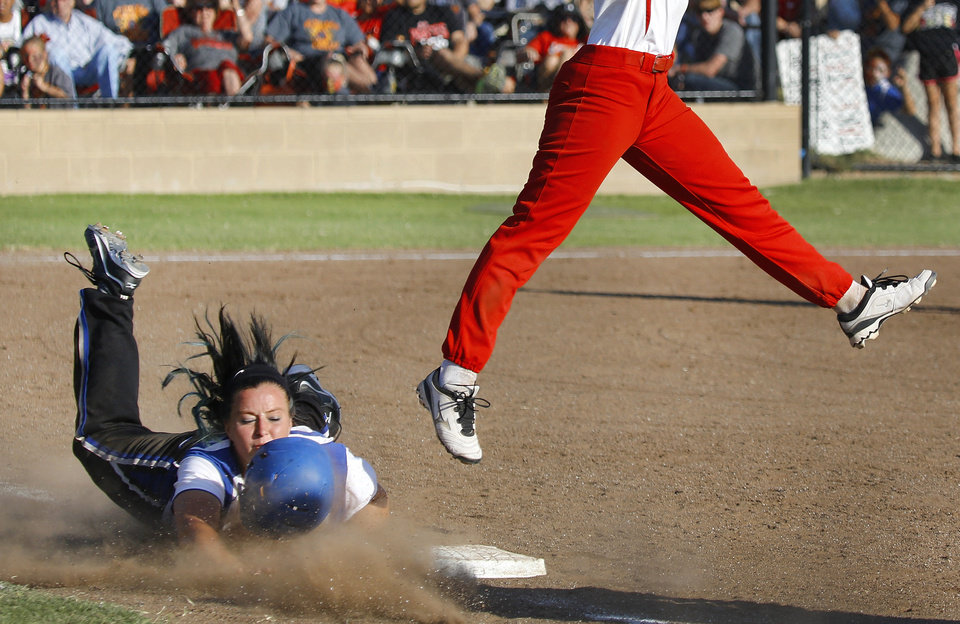 Savanna batter Jordin (cq) Wilson loses her helmet as she slides head-first to safely reach first base after Dale's Jaelin Flewallen is unable to make the leaping catch.  Class 2A softball championship game between Savanna and Dale  at Firelake Ball Fields in Shawnee on Saturday, Oct. 12, 2013. Dale won the game, 3-2.     Photo by Jim Beckel,  The Oklahoman.