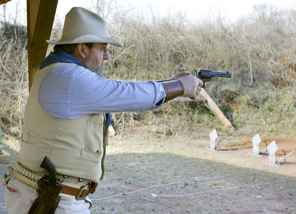 """The Kadashan Kid"", aka Jeff Grimes, from Sand Springs, OK, shoots a single action handgun during the Land Run, the biggest cowboy action shoot of the year Friday at the Oklahoma City Gun Club. Photo By Paul Hellstern, The Oklahoman"