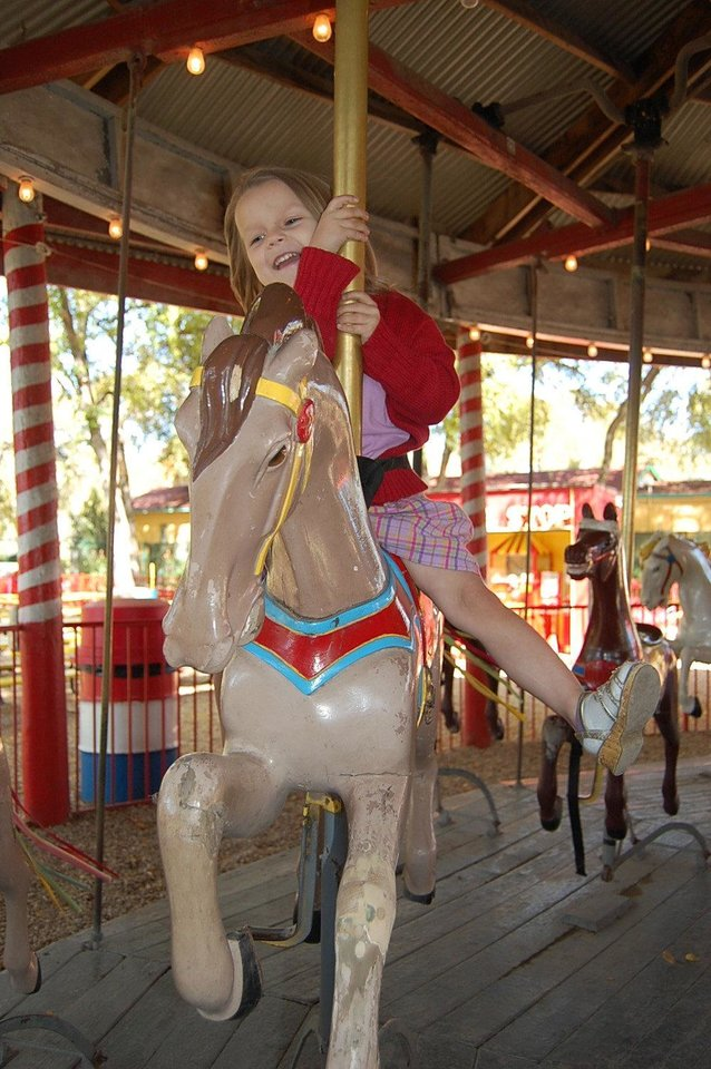 Miranda Price rides the 1918 carousel at Kiddie Park in San Antonio. Photo by Annette Price, for The Oklahoman. <strong></strong>