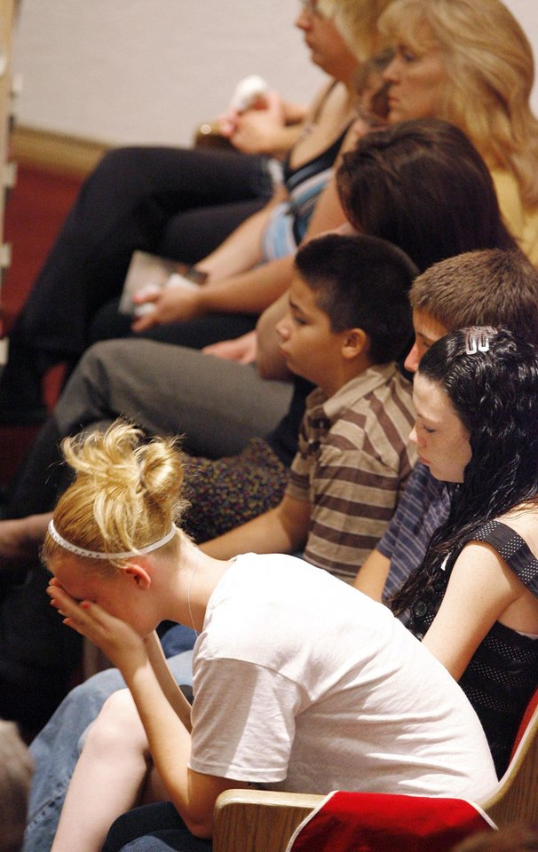 Photo - Junior Amber Shoebottom cries in her hands at Taylor Paschal-Placker's funeral in Dewar, Friday, June 13, 2008.  Taylor and her friend  Skyla Whitaker were shot and killed last Sunday on the dirt road near one of their homes, Thursday, June 12, 2008.    Photo by David McDaniel/The Oklahoman