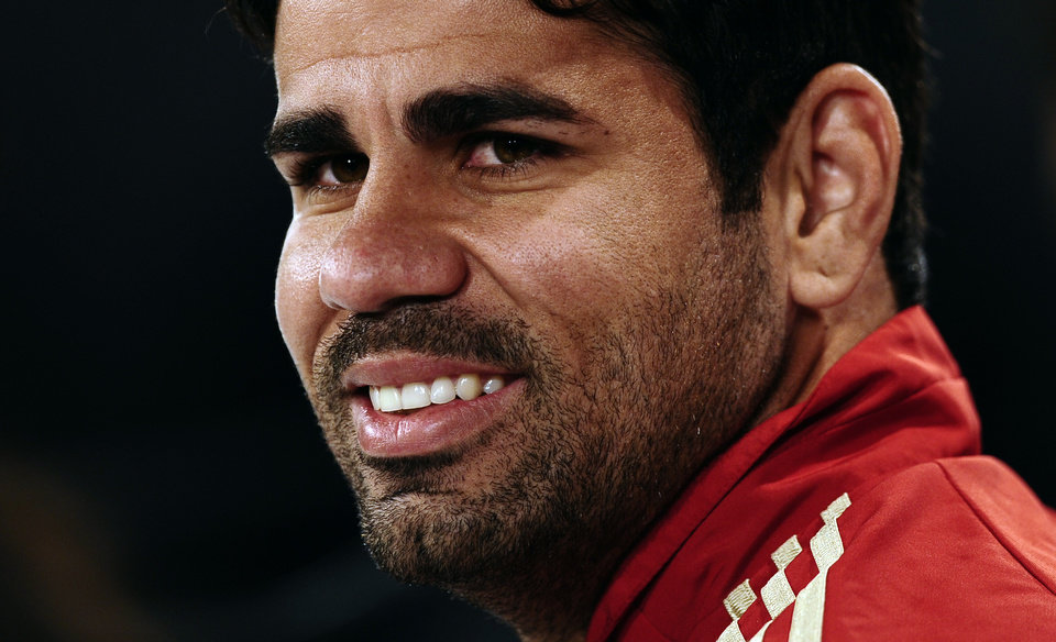 Photo - Spain's Diego Costa smiles during a press conference at the Atletico Paranaense training center in Curitiba, Brazil, Tuesday, June 10, 2014. Spain will play in group B of the Brazil 2014 soccer World Cup. (AP Photo/Manu Fernandez)