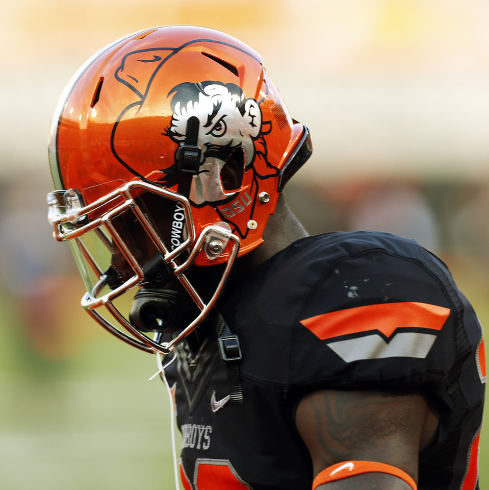 Photo - A view of the helmet of Oklahoma State's Juwan Offray (22) before a college football game between the Oklahoma State Cowboys (OSU) and the Texas Tech Red Raiders at Boone Pickens Stadium in Stillwater, Okla., Thursday, Sept. 25, 2014. Photo by Nate Billings, The Oklahoman