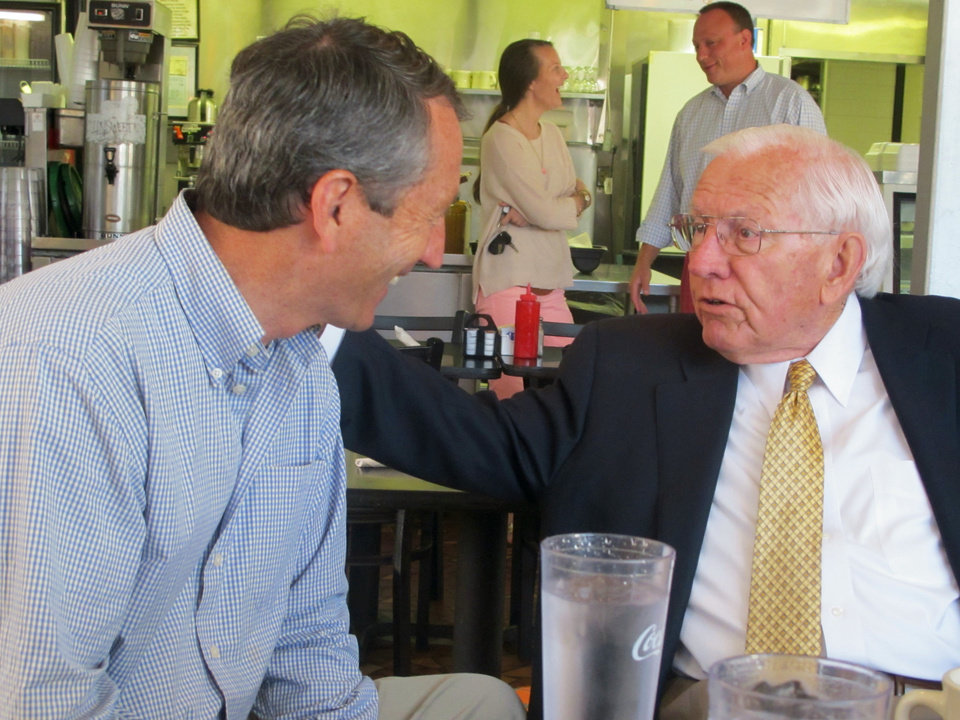 Photo - Mark Sanford, left, chats with former S.C. Gov. Jim Edwards during a campaign stop at a diner in Mount Pleasant, S.C., on Monday, May 6, 2012. Sanford faces Elizabeth Colbert Busch, the sister of comedian Stephen Colbert, in a special congressional election in the state's 1st District on Tuesday. Edwards was campaigning for Sanford on Monday. (AP Photo/Bruce Smith)