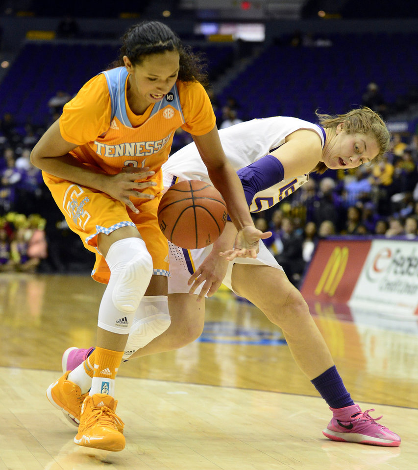 Photo - Tennessee's Mercedes Russell, left, steals the ball from LSU's Theresa Plaisance during an NCAA college basketball game in Baton Rouge, Thursday, Feb. 27, 2014. (AP Photo/The Baton Rouge Advocate, Catherine Threlkeld)  MANDATORY CREDIT, -ONLIN, MAGAZINES OUT, INTERNET OUT, TV OUT, NO SALES, NO FOREIGNS. LOUISIANA BUSINESS INC. OUT (INCLUDING GREATER BATON ROUGE BUSINESS REPORT, 225, 10/12, INREGISTER, LBI CUSTOM