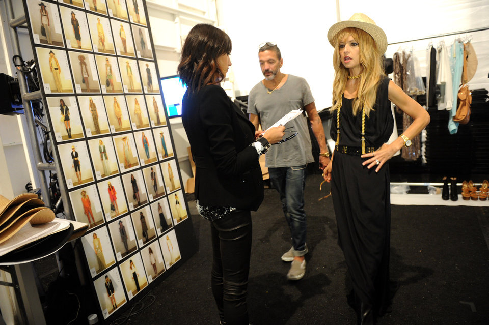 Photo -   Designer Rachel Zoe, right, is seen backstage before her spring 2013 collection is shown at Fashion Week, Wednesday, Sept. 12, 2012, in New York. (Photo by Diane Bondareff/Invision/AP)