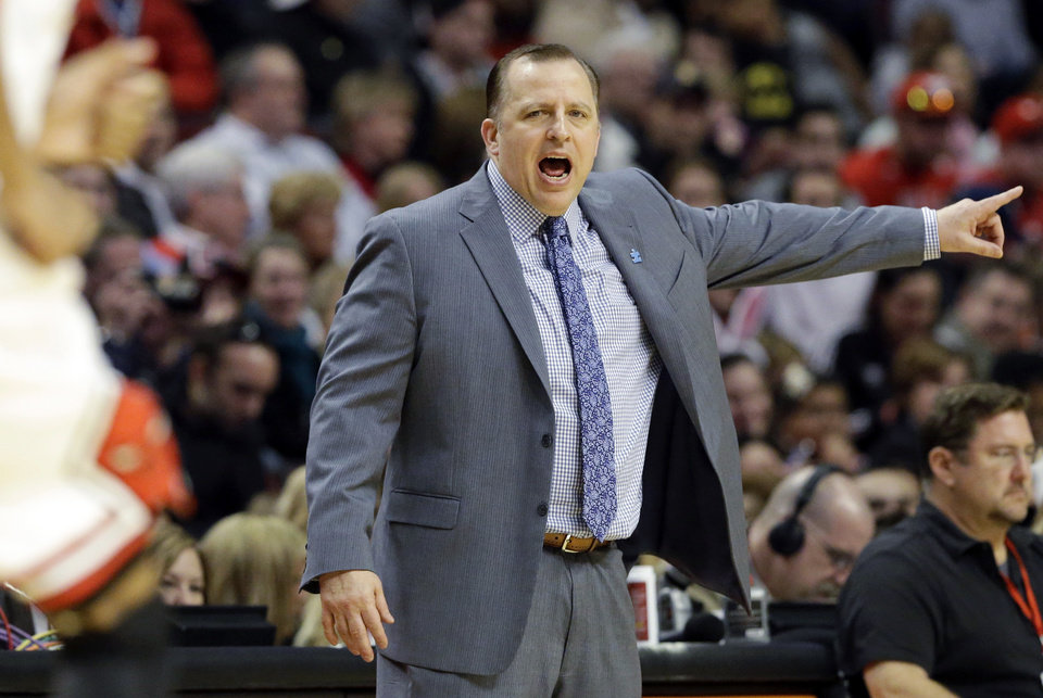 Photo - Chicago Bulls head coach Tom Thibodeau yells to his team during the first half of an NBA basketball game against the Detroit Pistons in Chicago, Sunday, March 31, 2013. (AP Photo/Nam Y. Huh)