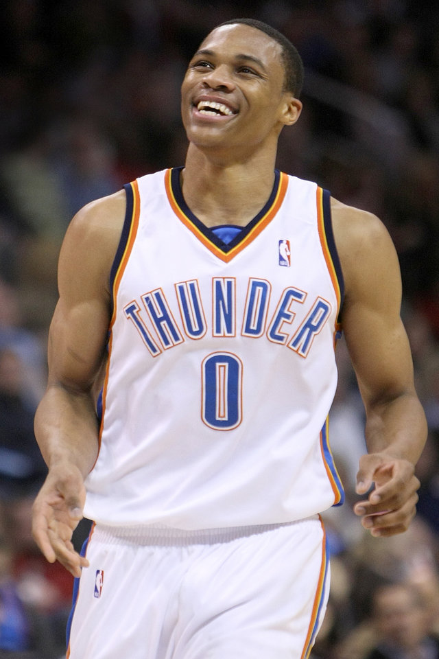 Photo - OKLAHOMA CITY THUNDER / UTAH JAZZ / NBA BASKETBALL  Oklahoma City Thunder guard Russell Westbrook is all smiles during the Thunder - Jazz game December 31, 2009 in the Ford Center in Oklahoma City.    BY HUGH SCOTT, THE OKLAHOMAN ORG XMIT: KOD