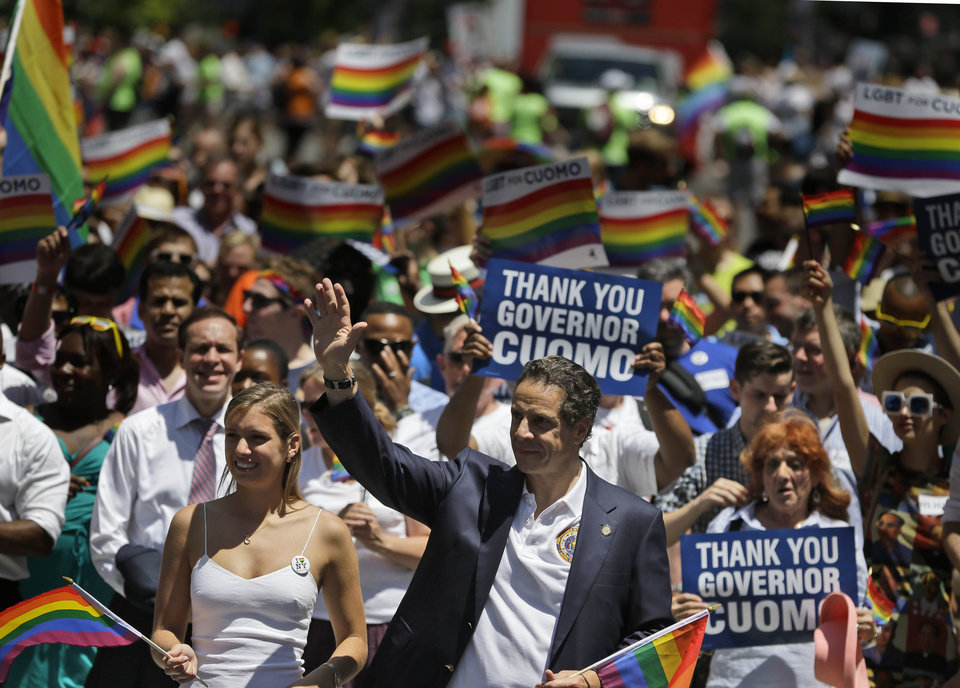 Photo - New York Gov. Andrew Cuomo marches in the Gay Pride Parade in New York, Sunday, June 29, 2014. Fifth Avenue became one big rainbow on Sunday, as thousands of participants waving multicolored flags made their way down the street for New York City's annual Gay Pride march. (AP Photo/Seth Wenig)
