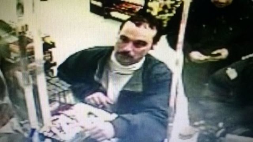 Photo - An imaage from a video surveillance camera release by the Michigan State Police shows Ionia Correctional Facility escapee Michael David Elliot, 40,   at an Indiana Marathon gas station late Sunday night.  A national manhunt was underway Monday for Elliot, a convicted killer who escaped Sunday from the Ionia Correctional Facility in Michigan.  (AP Photo/Michigan State Police)