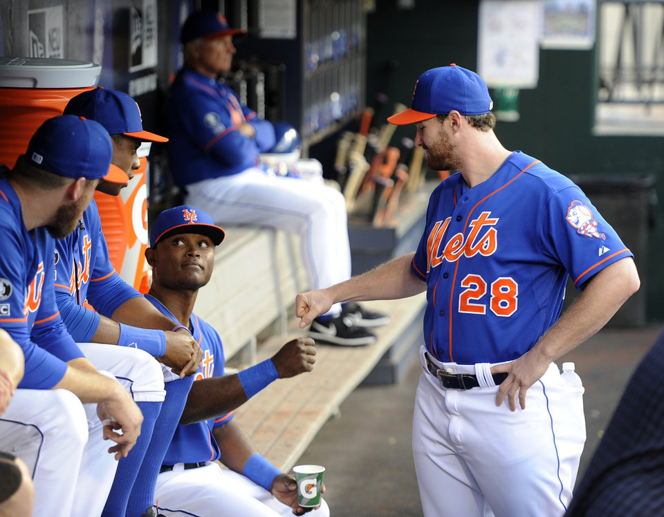Photo - New York Mets second baseman Daniel Murphy (28) greets teammate Dilson Herrara in the dugout before a baseball game against the Philadelphia Phillies at Citi Field on Friday, Aug. 29, 2014, in New York. Herrara was making his major league debut at second base Friday, replacing the injured Murphy. (AP Photo/Kathy Kmonicek)