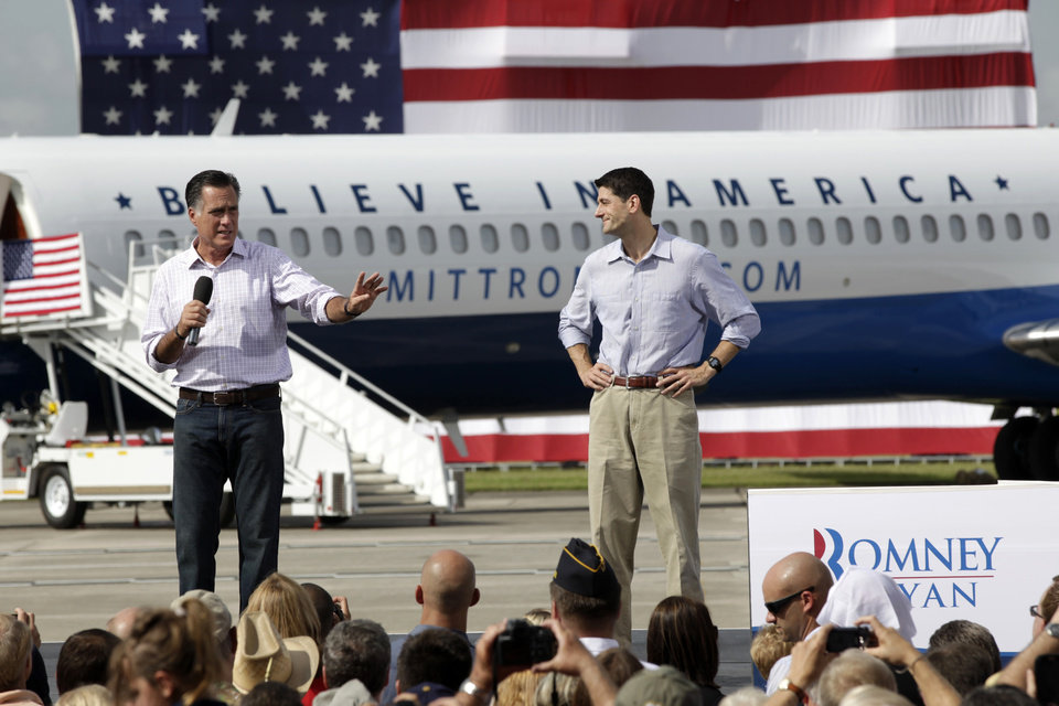 Photo -   Republican presidential candidate Mitt Romney, accompanied by his vice presidential running mate Rep. Paul Ryan, R-Wis., speaks during a campaign event at Lakeland Linder Regional Airport in Lakeland, Fla., Friday, Aug. 31, 2012. (AP Photo/Mary Altaffer)