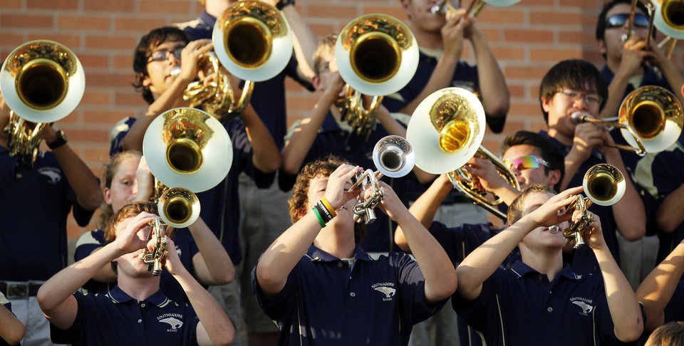 Photo - The Southmoore band plays in the stands during a high school football game between Southmoore and Carl Albert at Moore Schools Stadium in Moore, Okla., Thursday, Sept. 5, 2013.  Photo by Nate Billings, The Oklahoman