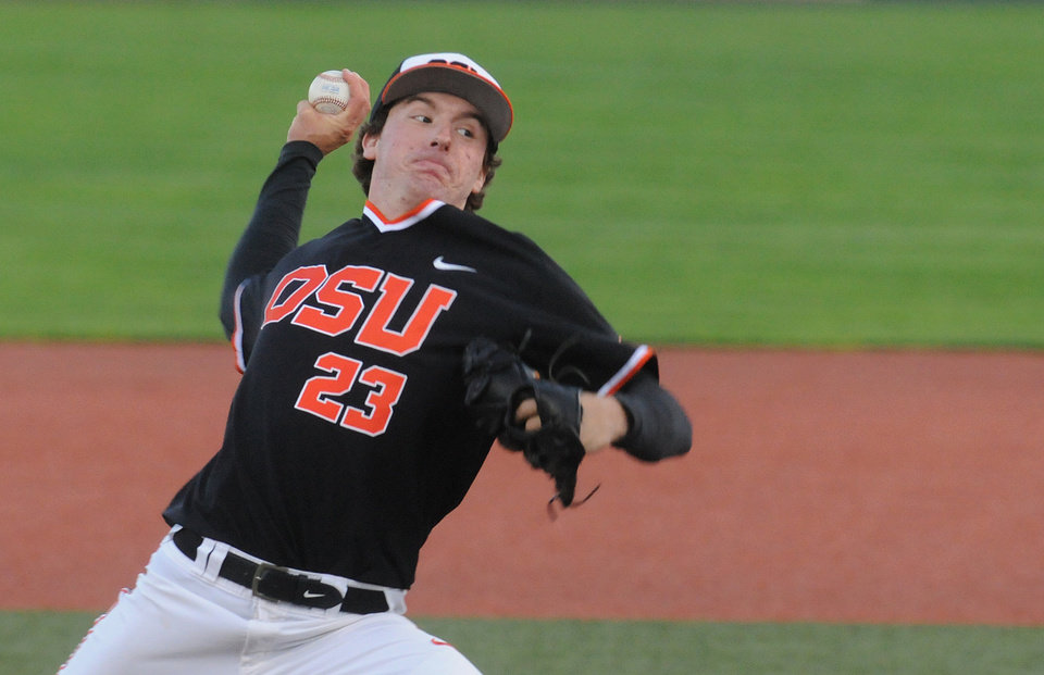 Photo - Oregon State starter Andrew Moore delivers a pitch against North Dakota State during an NCAA college baseball tournament regional game in Corvallis, Ore., Friday, May 30, 2014. (AP Photo/Mark Ylen)