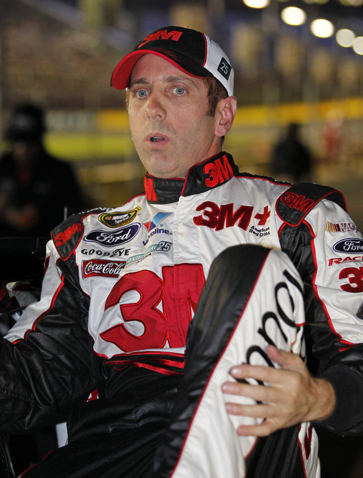 Greg Biffle climbs from his car after qualifying for Saturday's NASCAR Bank of America 500 Sprint Cup series auto race in Concord, N.C., Thursday, Oct. 11, 2012. Biffle won the pole position for the race. (AP Photo/Terry Renna)