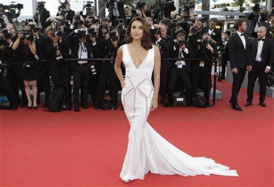 Photo - Actress Eva Longoria arrives for the screening of Rust and Bone at the 65th international film festival, in Cannes, southern France, Thursday, May 17, 2012.  Longoria is wearing Emilio Pucci.(AP Photo/Francois Mori)