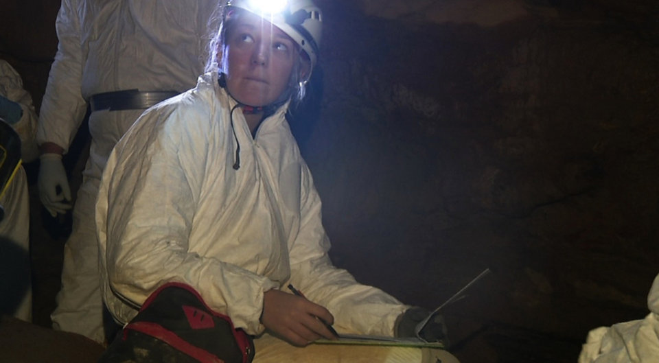 Photo - CORRECTS ID OF SUBJECT TO JACKIE JEFFREY, NOT KATRINA MORRIS - In this image from video, Jackie Jeffrey, a wildlife technician at the Georgia Department of Natural Resources, searches for signs of white-nose syndrome inside a cave near Atlanta. The disease that has killed more than 6 million cave-dwelling bats in the United States is on the move and wildlife biologists are worried. It gets its name from a white fungus that's found on the muzzles, ears and wings of infected bats. In Tennessee, some caves are closed to the public. At Mammoth Cave National Park, visitors are required to scrub their shoes after cave tours. Wildlife biologists say the threat is real -- there is no known way to stop the spread. (AP Photo/Alex Sanz)