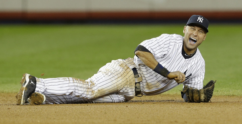 Photo -   New York Yankees shortstop Derek Jeter reacts after injuring himself in the 12th inning of Game 1 of the American League championship series against the Detroit Tigers Sunday, Oct. 14, 2012, in New York. (AP Photo/Paul Sancya )