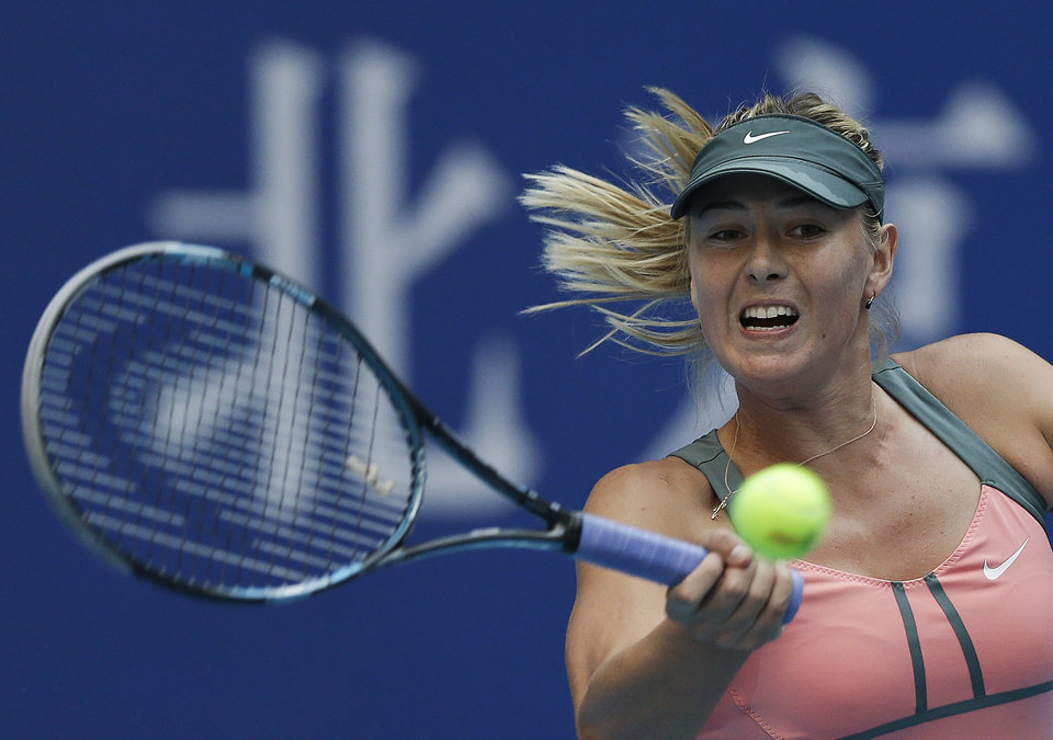 Photo -   Russia's Maria Sharapova hits a return shot to Angelique Kerber of Germany during their women's singles quarterfinal match of the China Open tennis tournament in Beijing Friday, Oct. 5, 2012. Sharapova won 6-0, 3-0 after Kerber retired with an injury. (AP Photo/Andy Wong)