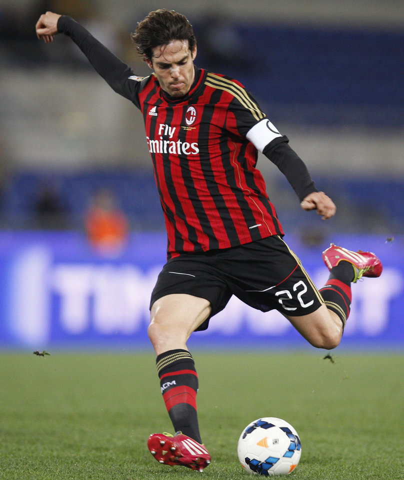 Photo - FILE - In this March 23, 2014 file photo, AC Milan's Kaka kicks the ball during a soccer match against Lazio at Rome's Olympic Stadium. Kaka has ended his contract with AC Milan, leaving him free to sign with Orlando City Soccer Club. Kaka will fly to the United States on Monday night, June 30, 2014, to sign with the new Major League Soccer franchise. (AP Photo/Andrew Medichini)