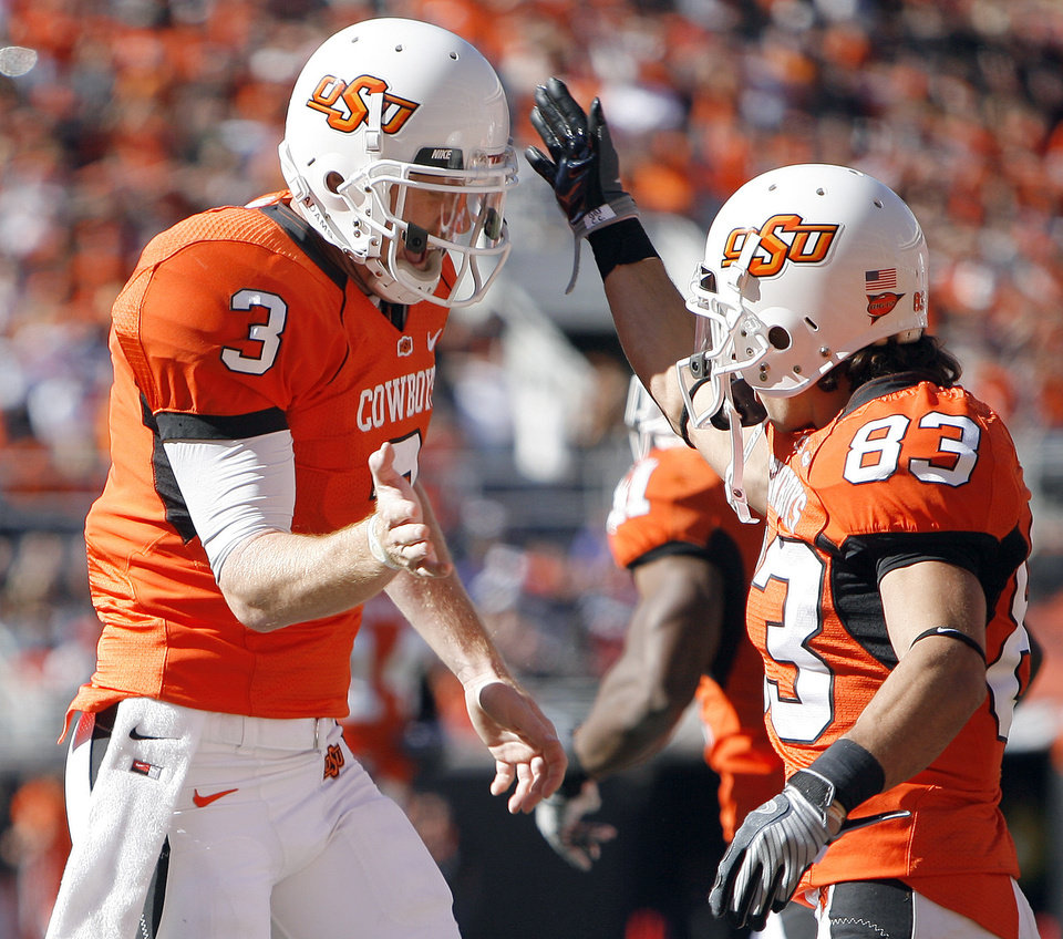 Photo - OSU's Brandon Weeden celebrates a touchdown with Colton Chelf during the college football game between the Oklahoma State University Cowboys (OSU) and the Baylor University Bears at Boone Pickens Stadium in Stillwater, Okla., Saturday, Nov. 6, 2010. Photo by Sarah Phipps, The Oklahoman