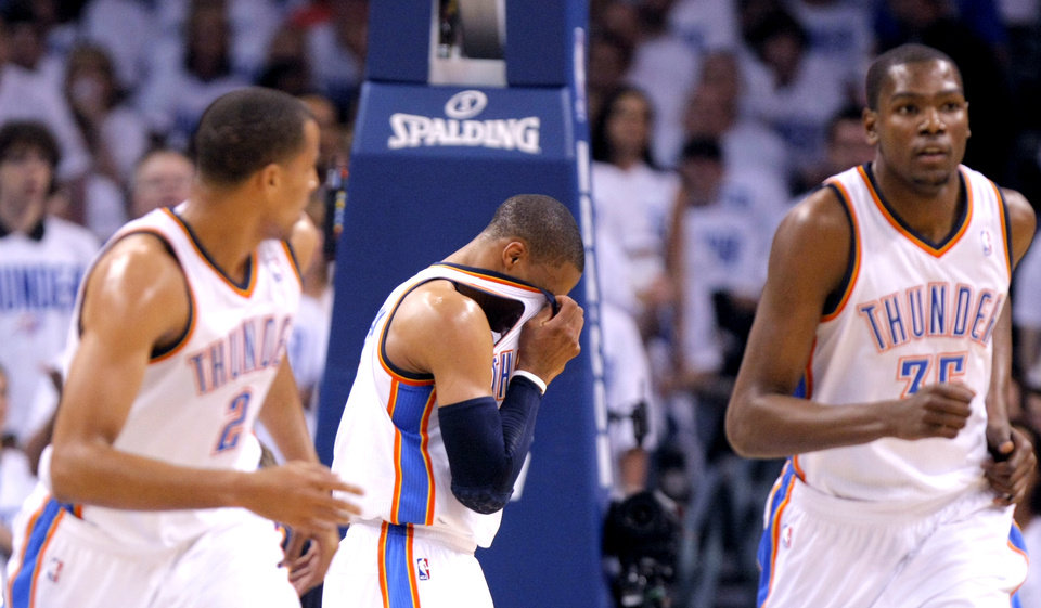 Photo - Oklahoma City's Russell Westbrook (0) reacts after taking fall during game five of the Western Conference semifinals between the Memphis Grizzlies and the Oklahoma City Thunder in the NBA basketball playoffs at Oklahoma City Arena in Oklahoma City, Wednesday, May 11, 2011. Photo by Sarah Phipps, The Oklahoman