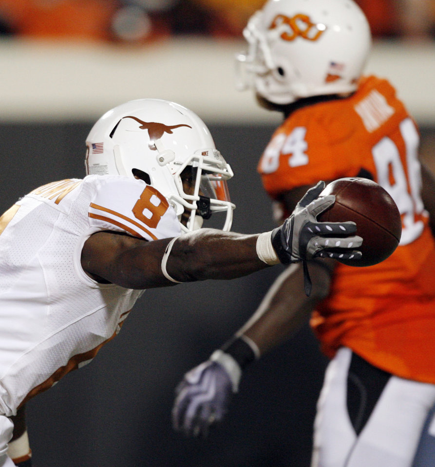 Photo - Chykie Brown (8) of Texas celebrates intercepting a pass intended for OSU's Hubert Anyiam (84) during the college football game between the Oklahoma State University Cowboys (OSU) and the University of Texas Longhorns (UT) at Boone Pickens Stadium in Stillwater, Okla., Saturday, Oct. 31, 2009. Texas won, 41-14. Photo by Nate Billings, The Oklahoman