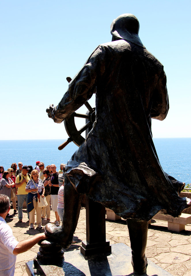 Photo - This May 13, 2013 photo shows tourists checking out a larger-than-life statue of Albert I, an oceanographer who served as prince of Monaco from 1889 until his death in 1922. The statue is part of the St. Martin Gardens, which is free to visit and makes a nice place to stroll, with views of the Mediterranean. (AP Photo/Michelle Locke)