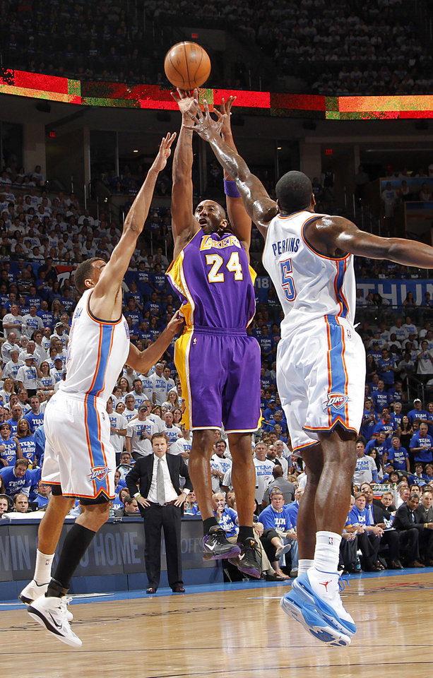 Photo - Los Angeles' Kobe Bryant shoots the ball over Oklahoma City's Thabo Sefolosha and Kendrick Perkins during Game 2 in the second round of the NBA playoffs between the Oklahoma City Thunder and the L.A. Lakers at Chesapeake Energy Arena on Wednesday,  May 16, 2012, in Oklahoma City, Oklahoma. Photo by Chris Landsberger, The Oklahoman